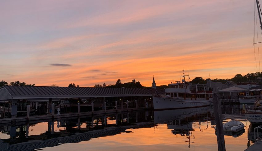 sunset view of harbor springs waterfront