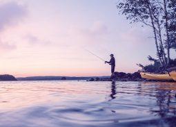 man fishing in lake michigan